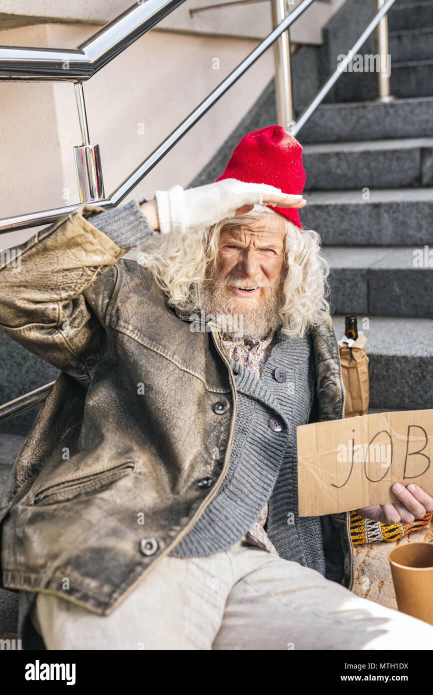Sad elderly man being jobless - Stock Image