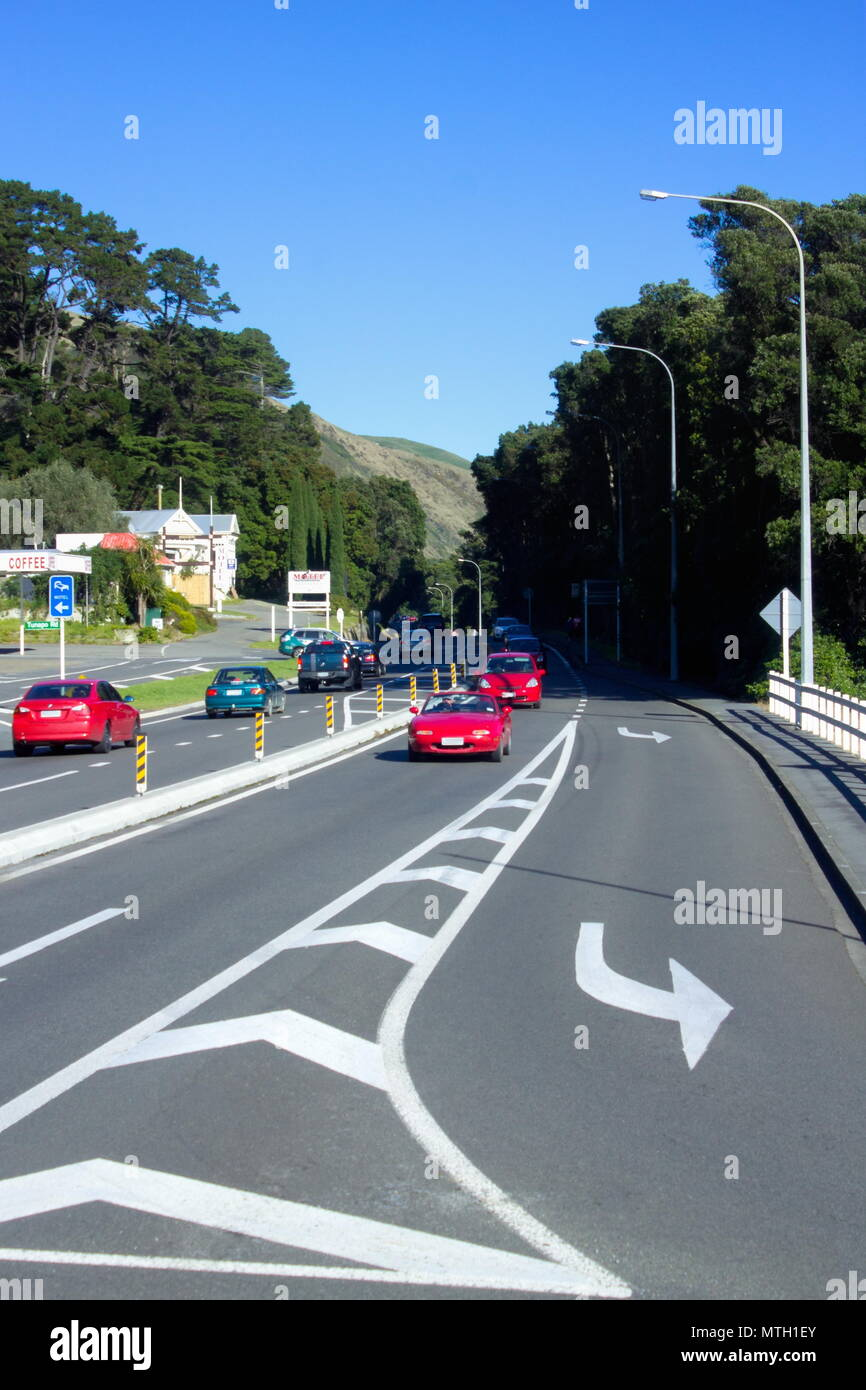 Paekakariki, New Zealand - 4 June 2016: Traffic travelling along State Highway One at the main Paekakariki intersection. - Stock Image