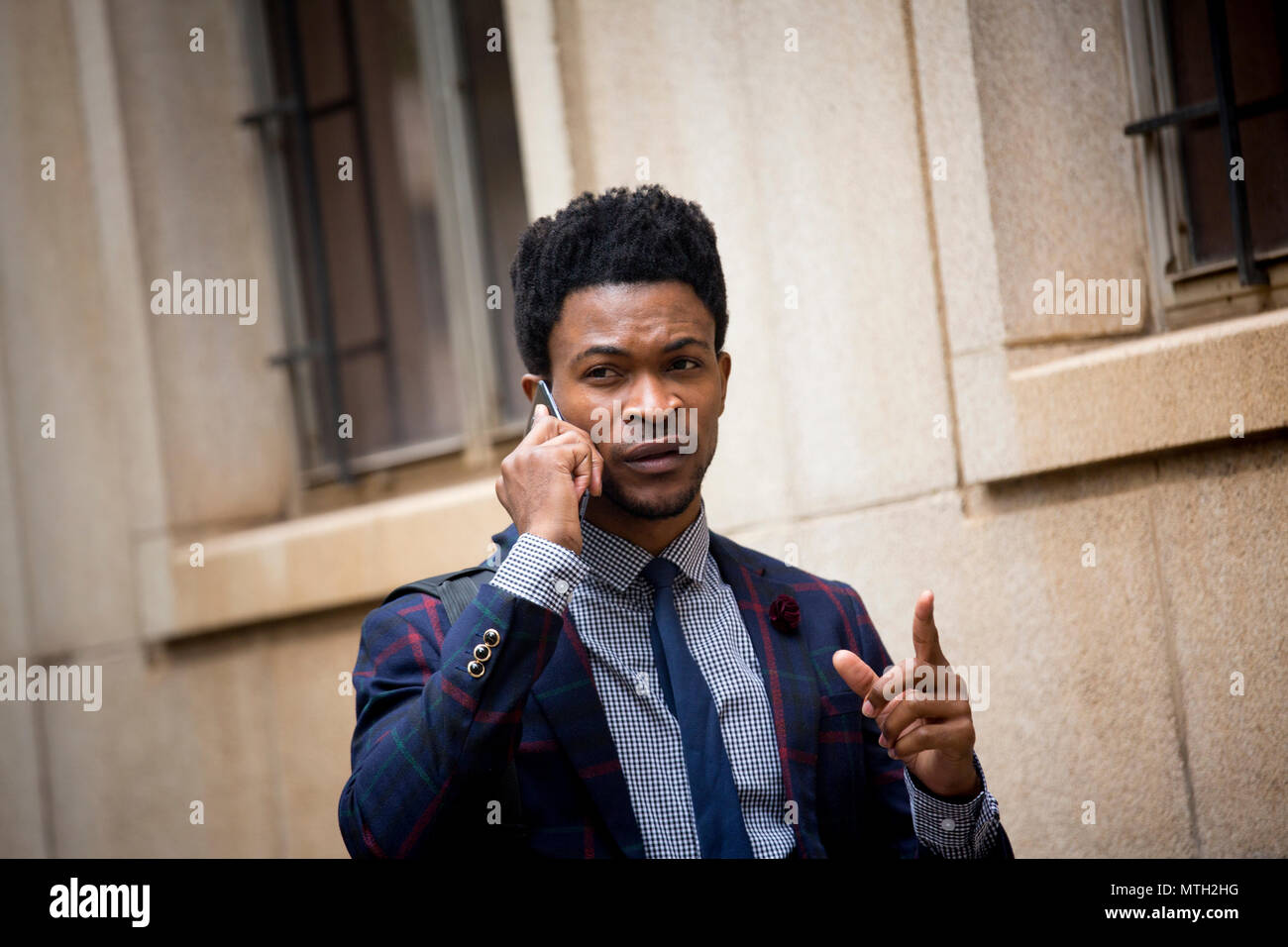 Close up business man on a phone call - Stock Image