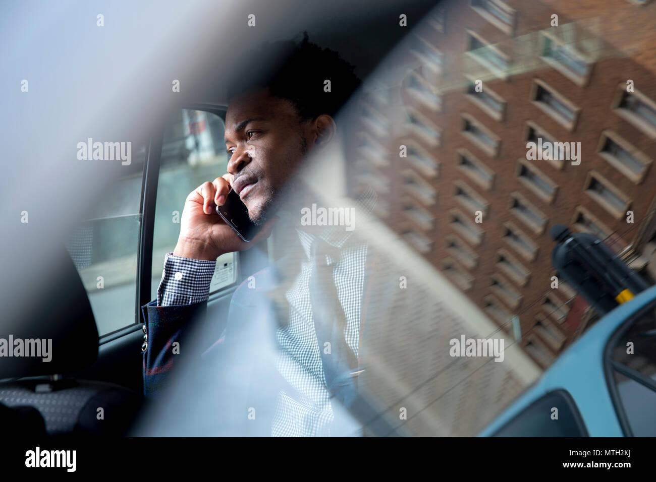 Business man seen through car window - Stock Image