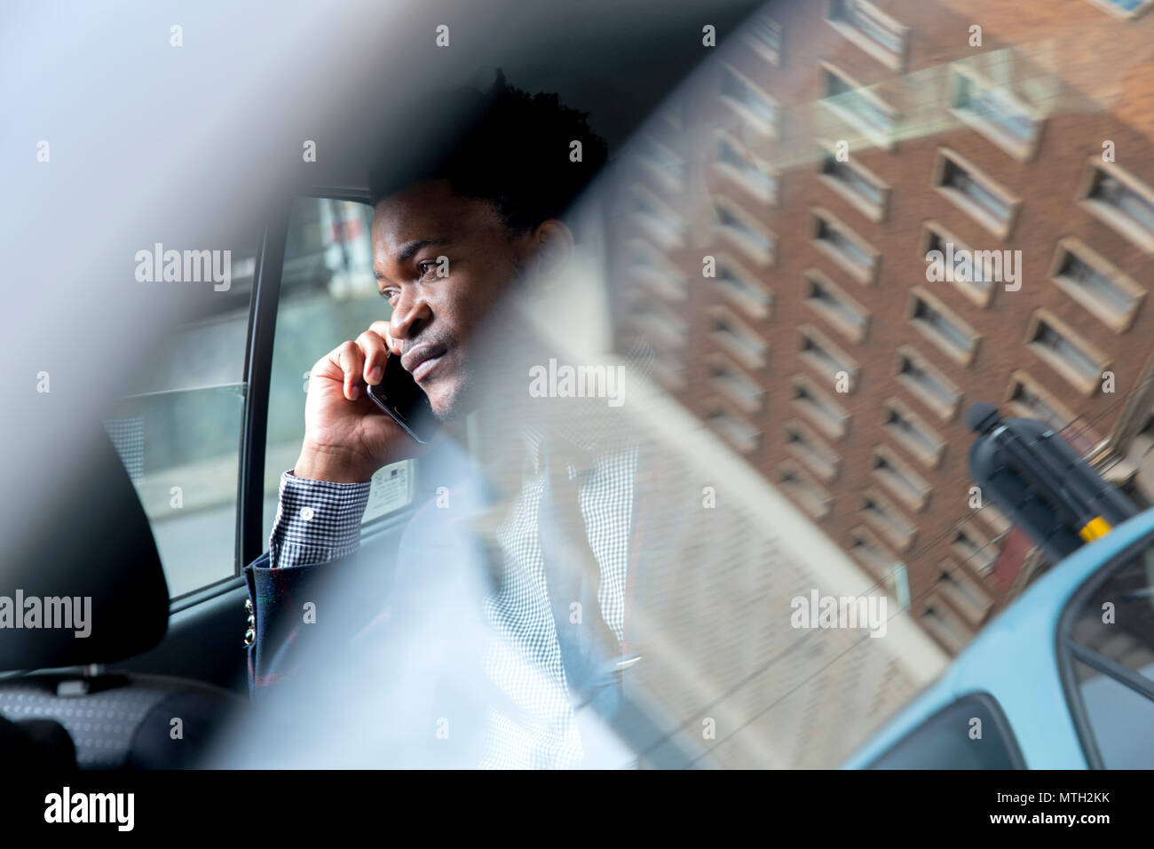 Business man seen through car window - Stock Image