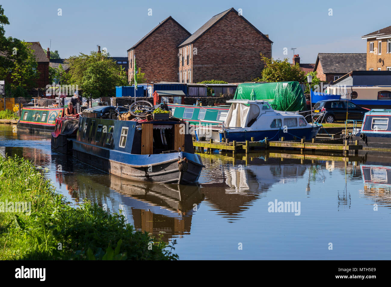 Waterborne Travelling Blacksmith on Macclesfield Canal - Stock Image