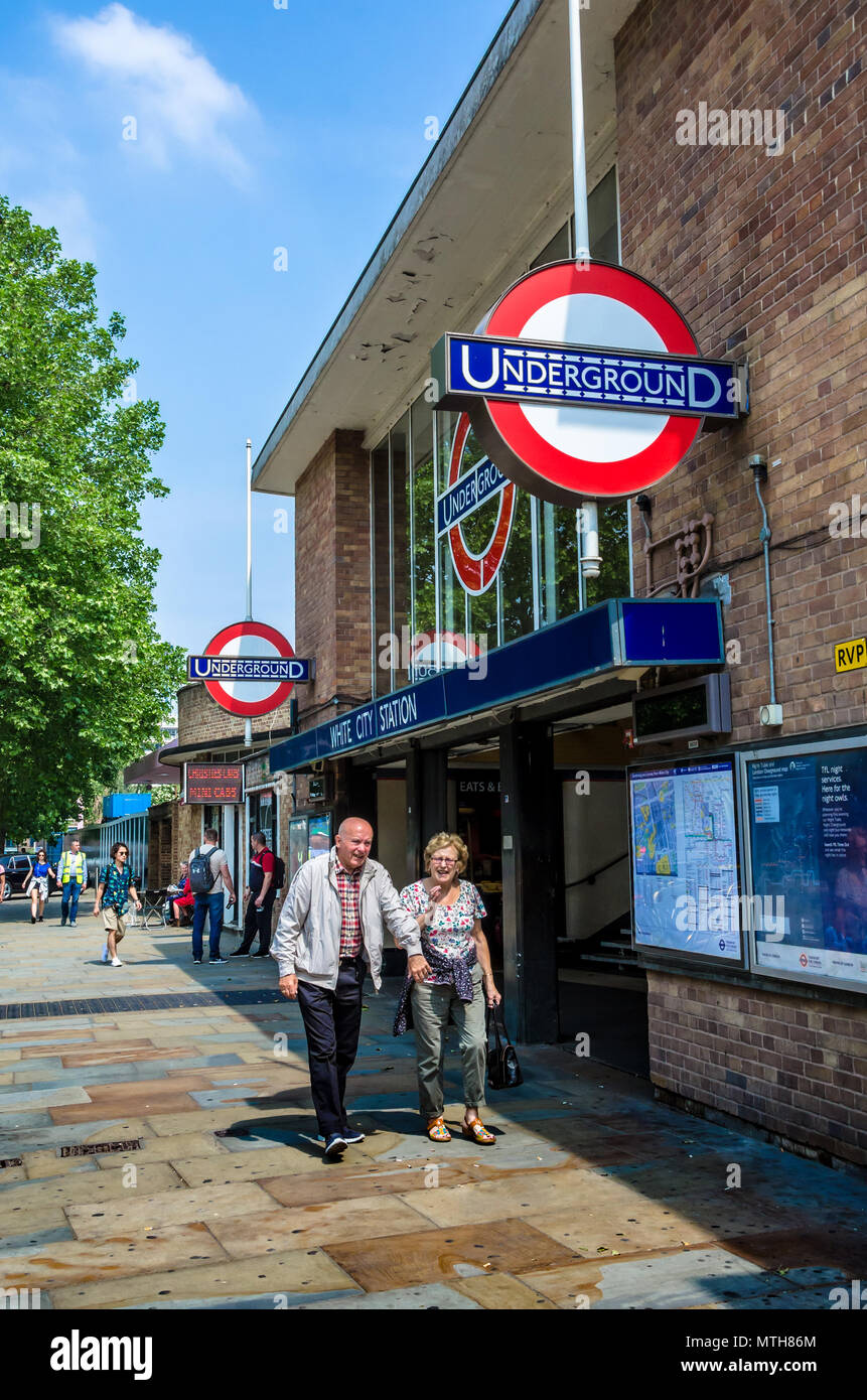 A view of the front of White City London Underground Station as seen from Wood Lane. - Stock Image