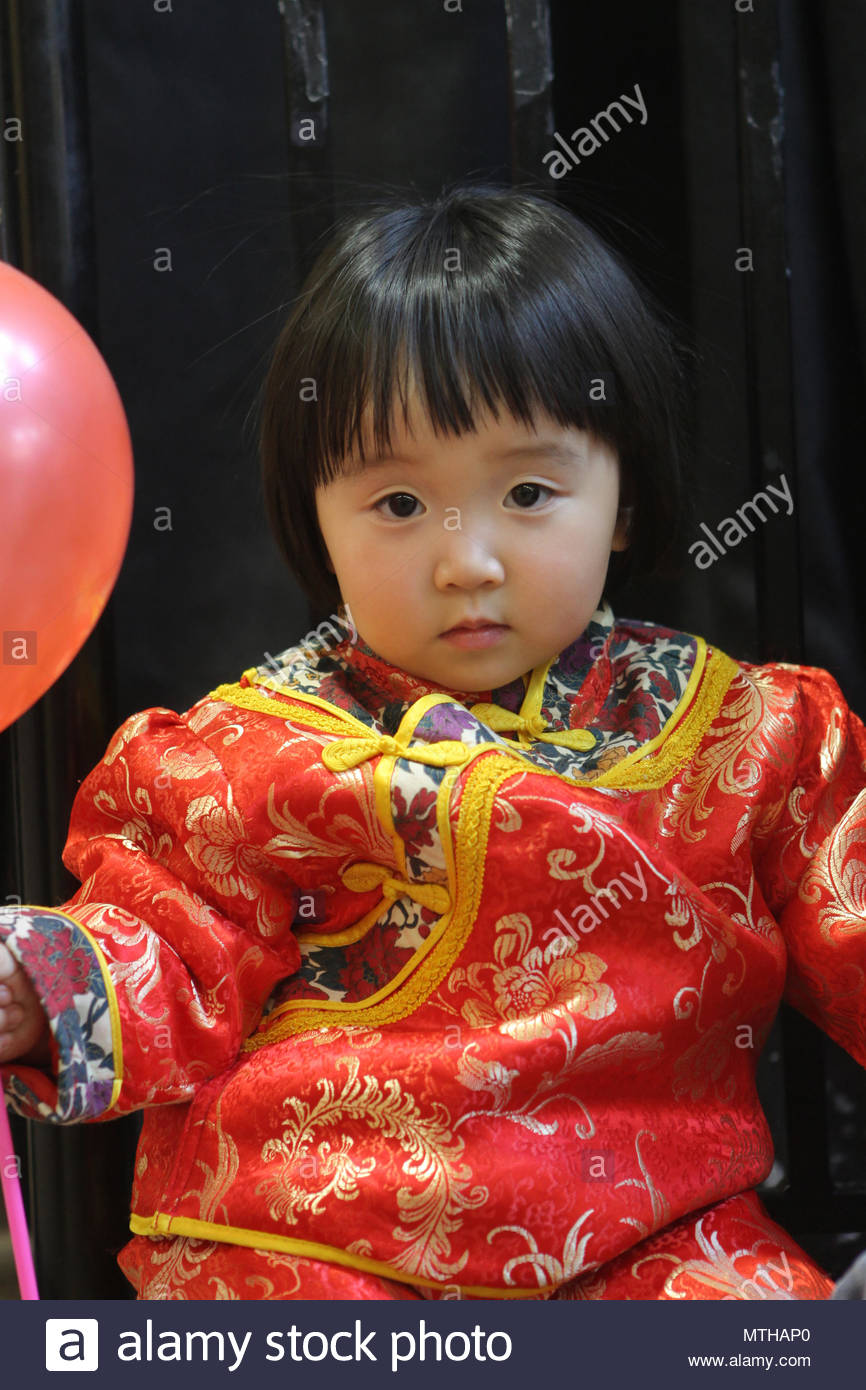 Chinese Girl Wearing A Traditional Outfit During Celebrations For The Chinese Lunar New Year Of The Snake Stock Photo Alamy