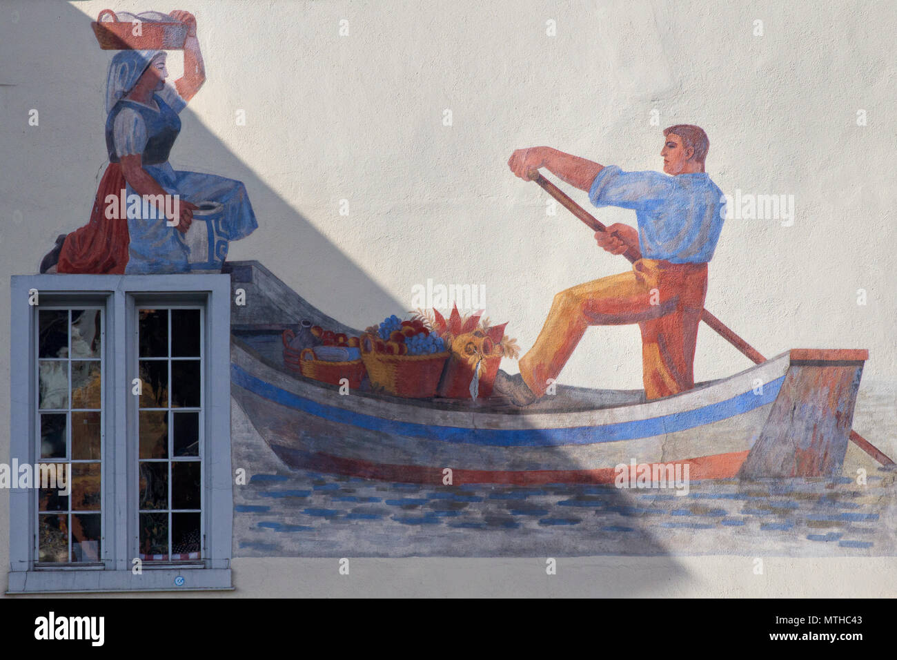 Inhabitant of Zurich way of life in the old times (fresco on a house along the river Limmet) - Stock Image