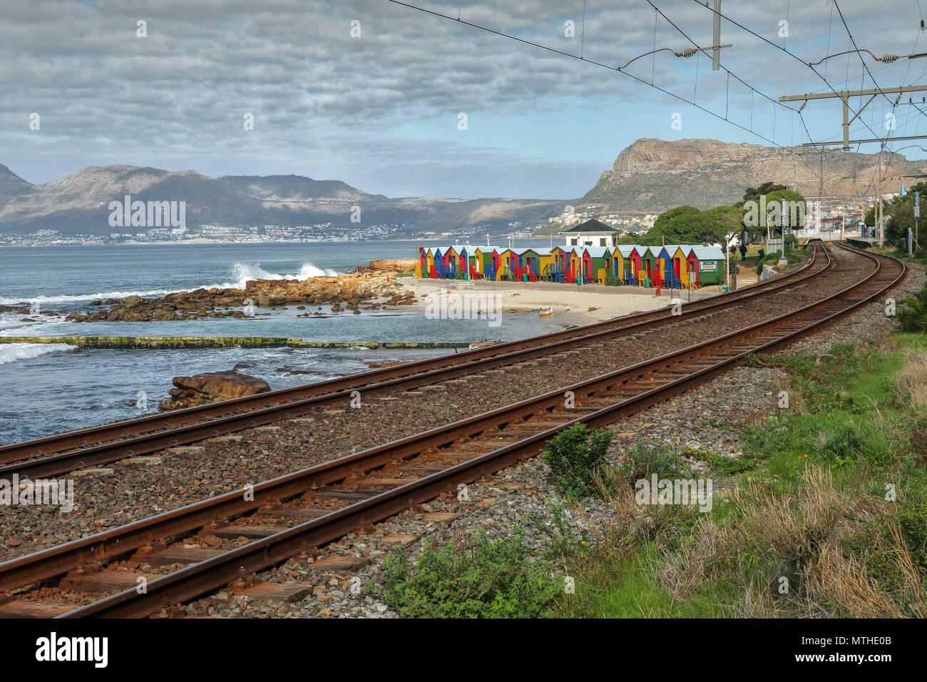 Railway tracks and beach huts on Glencairn beach, simondstown, garden route, south africa - Stock Image