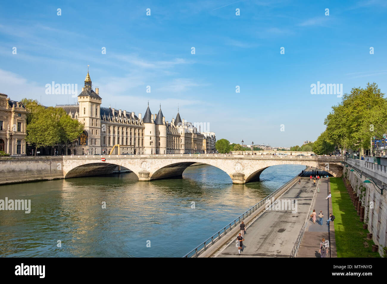 Seine River in Paris with the Conciergerie and Pont au Change in the background. - Stock Image
