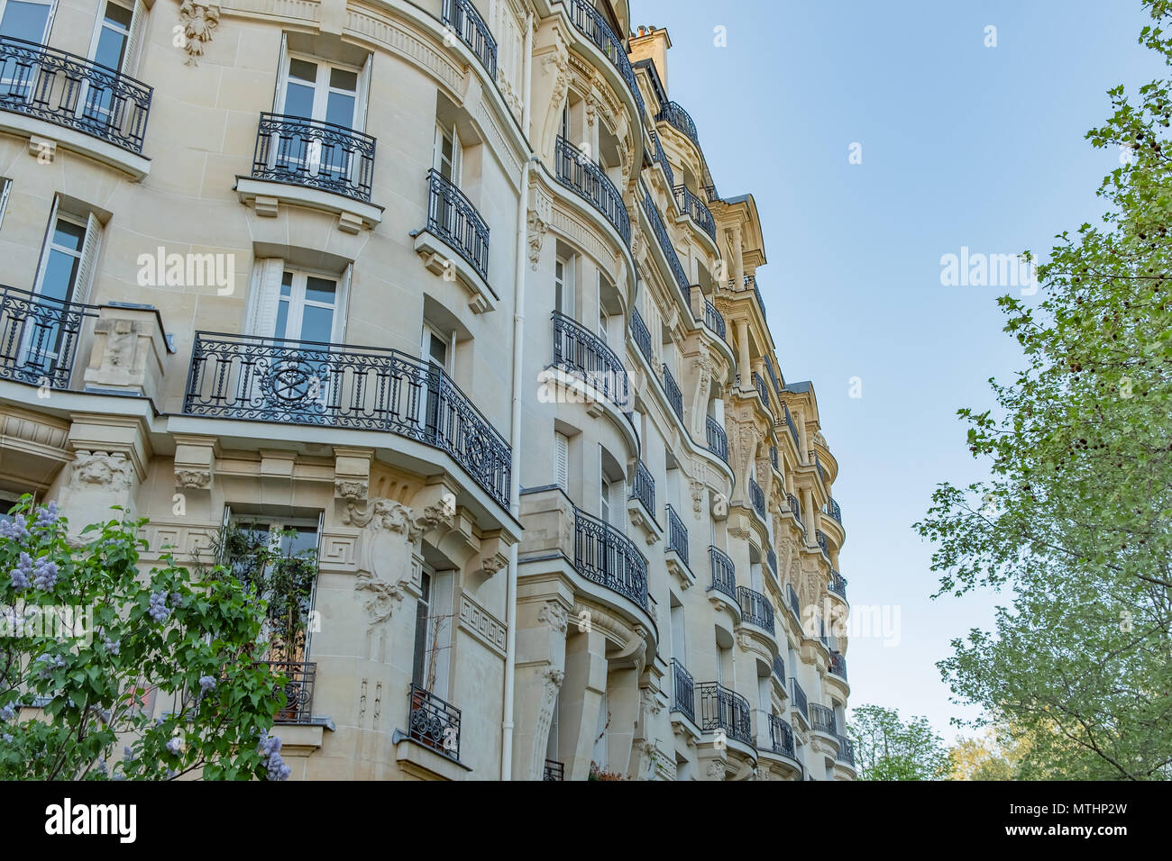 Looking up at a typical old Paris apartment building. - Stock Image