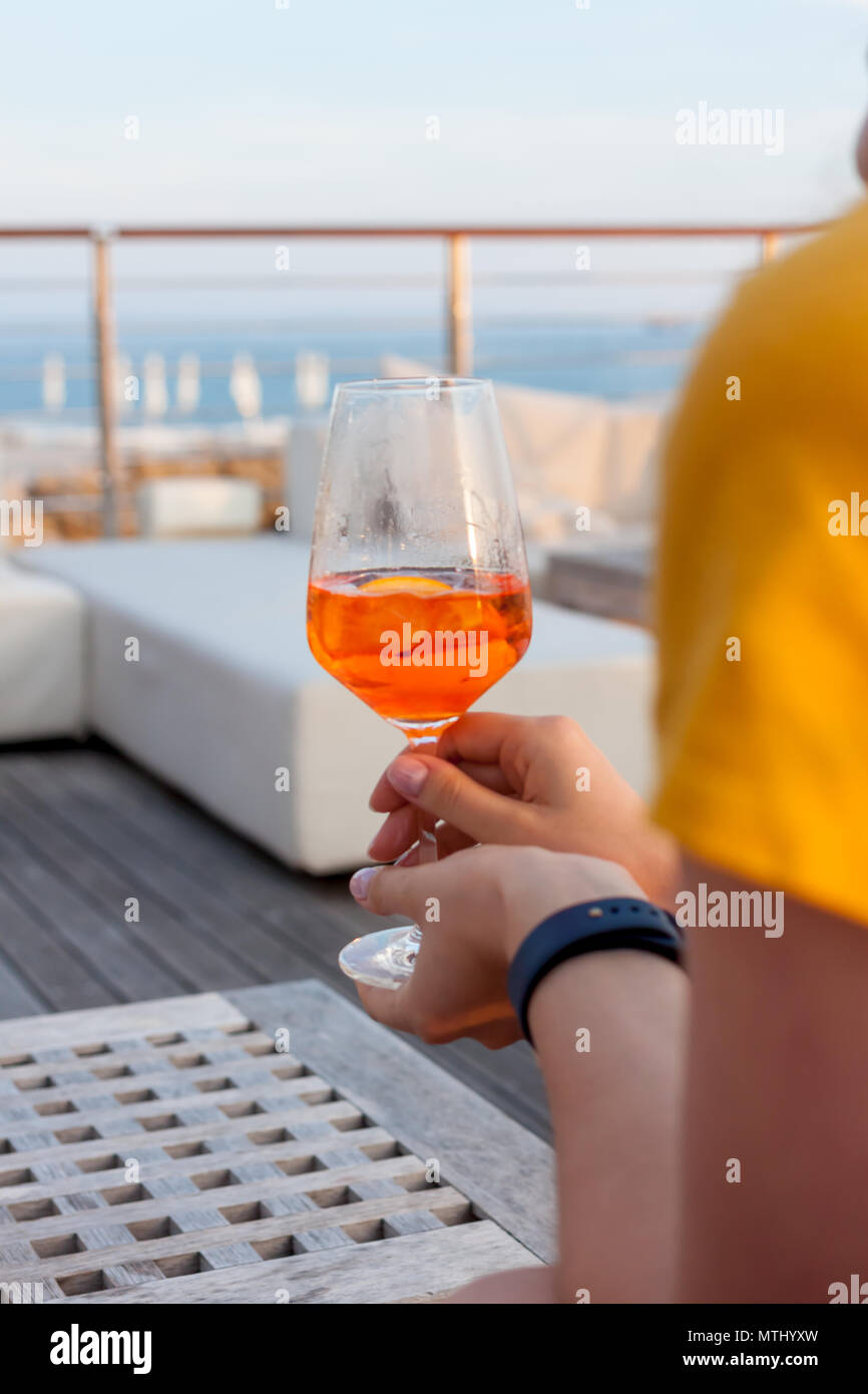 female hand with glass of aperol spritz - Stock Image