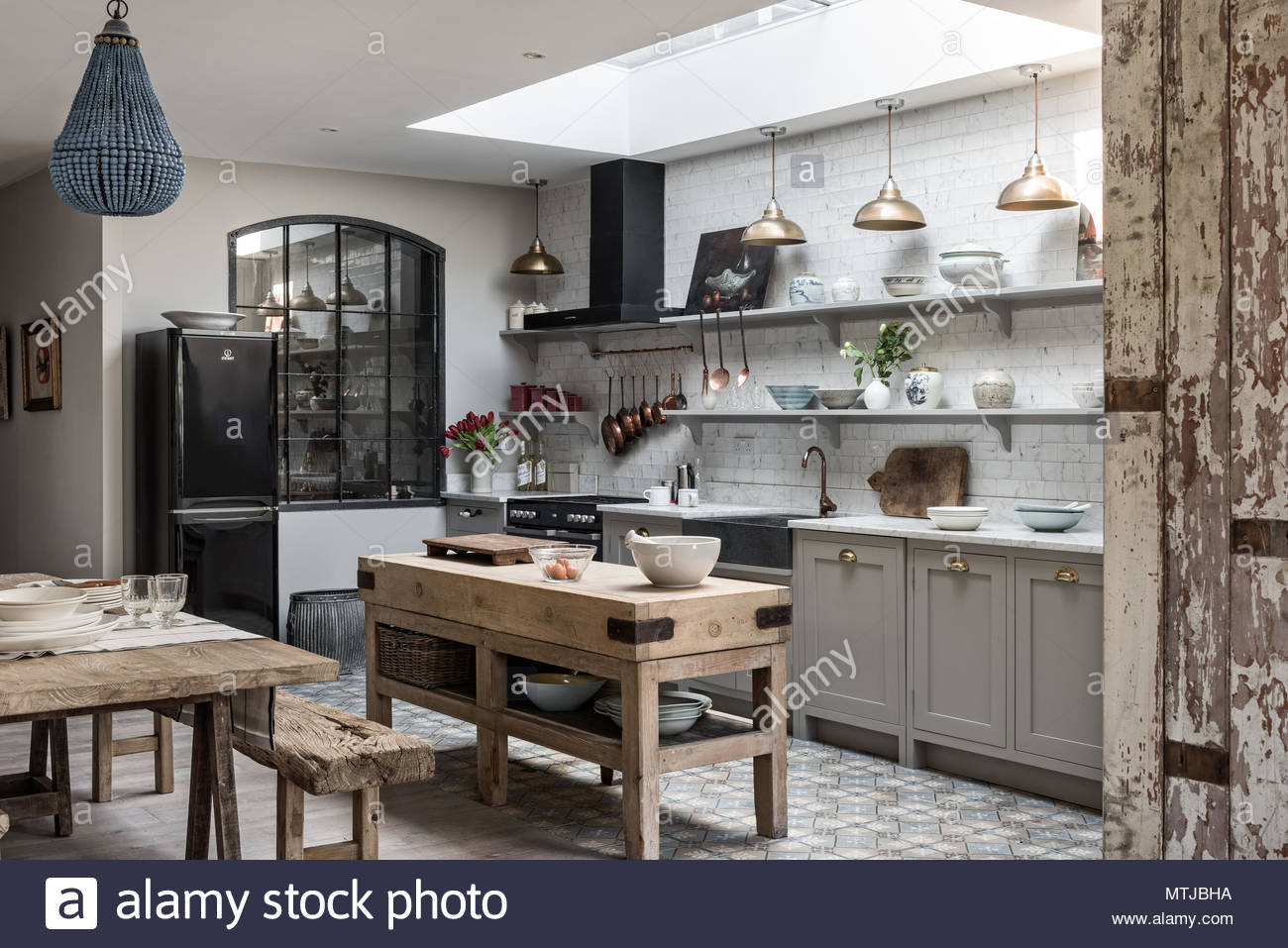 Open Plan Sophisticaed Kitchen With Vintage Brass Pendant Lighting Rustic Wooden Butchers Island And Beaded Chandelier From Graham Green