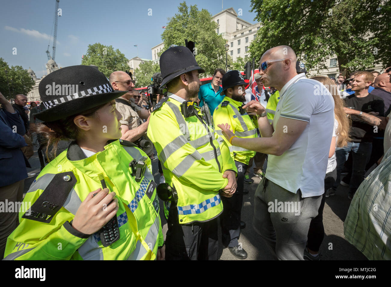Nationalist supporters of Tommy Robinson protest opposite Downing Street in London against his recent imprisonment for contempt of court. - Stock Image
