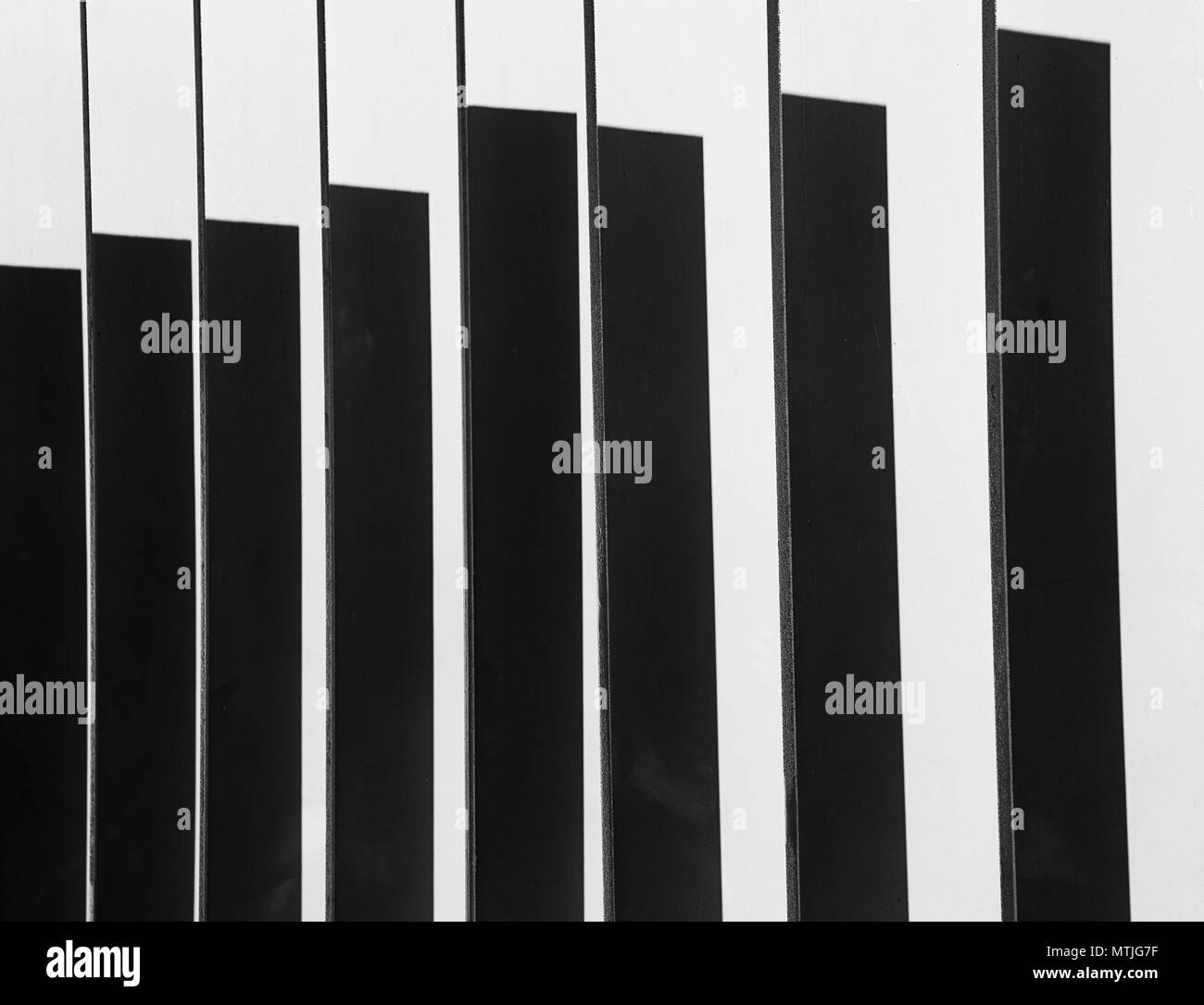 Shadows on the metal panel of the fence outside the White Cube Gallery, London, UK - Stock Image