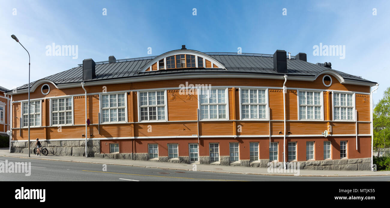 Panoramic view on the facade of an old, traditionally built wooden house from the city of Kuopio in the province of Savo in Eastern Finland. - Stock Image