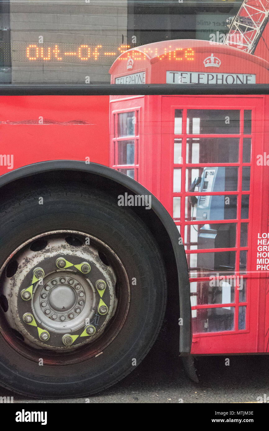 an image of a red uk phone box on the side of a red london bus or routemaster. Iconic english telephone box and red london double-decker bus. - Stock Image