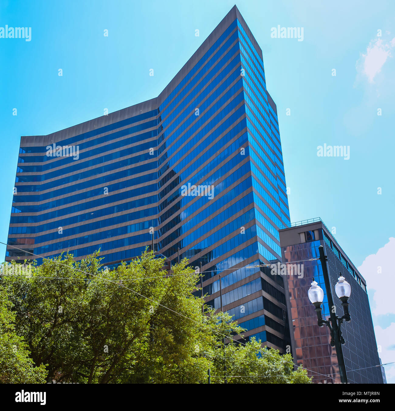 New Orleans, LA - Sep. 24, 2017: Poydras Center - it is a sleek, angular glass, class-A office tower. - Stock Image