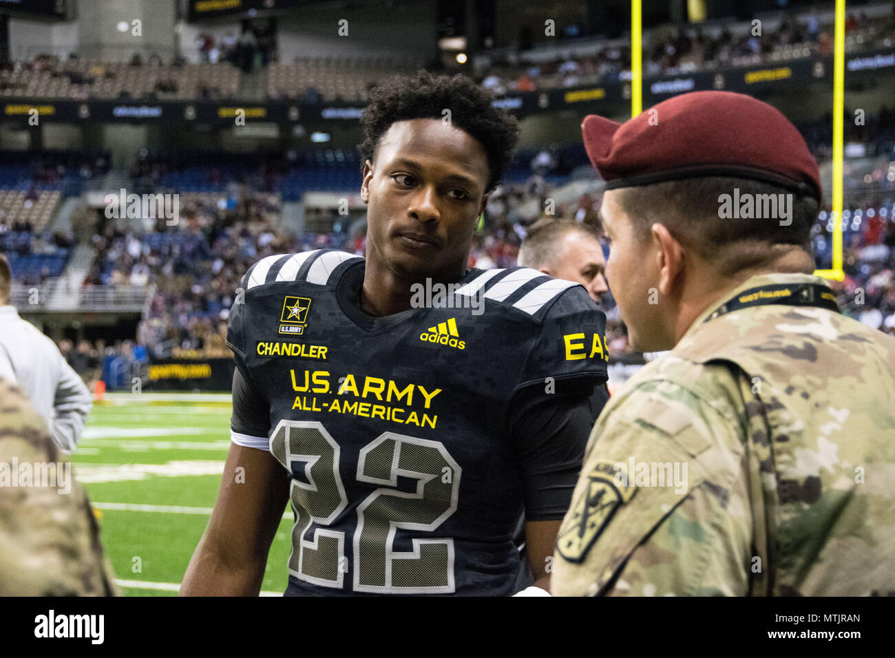 144c0acafce A USASOC Soldier encourages East team running back Ty Chandler