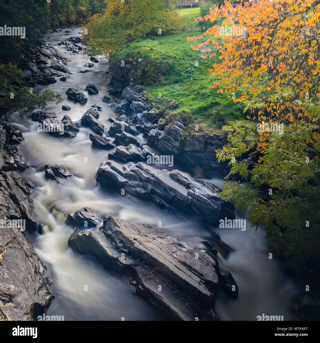 The closer i got the louder the stream was crashing down the rocks on a perfect fall day - Stock Image