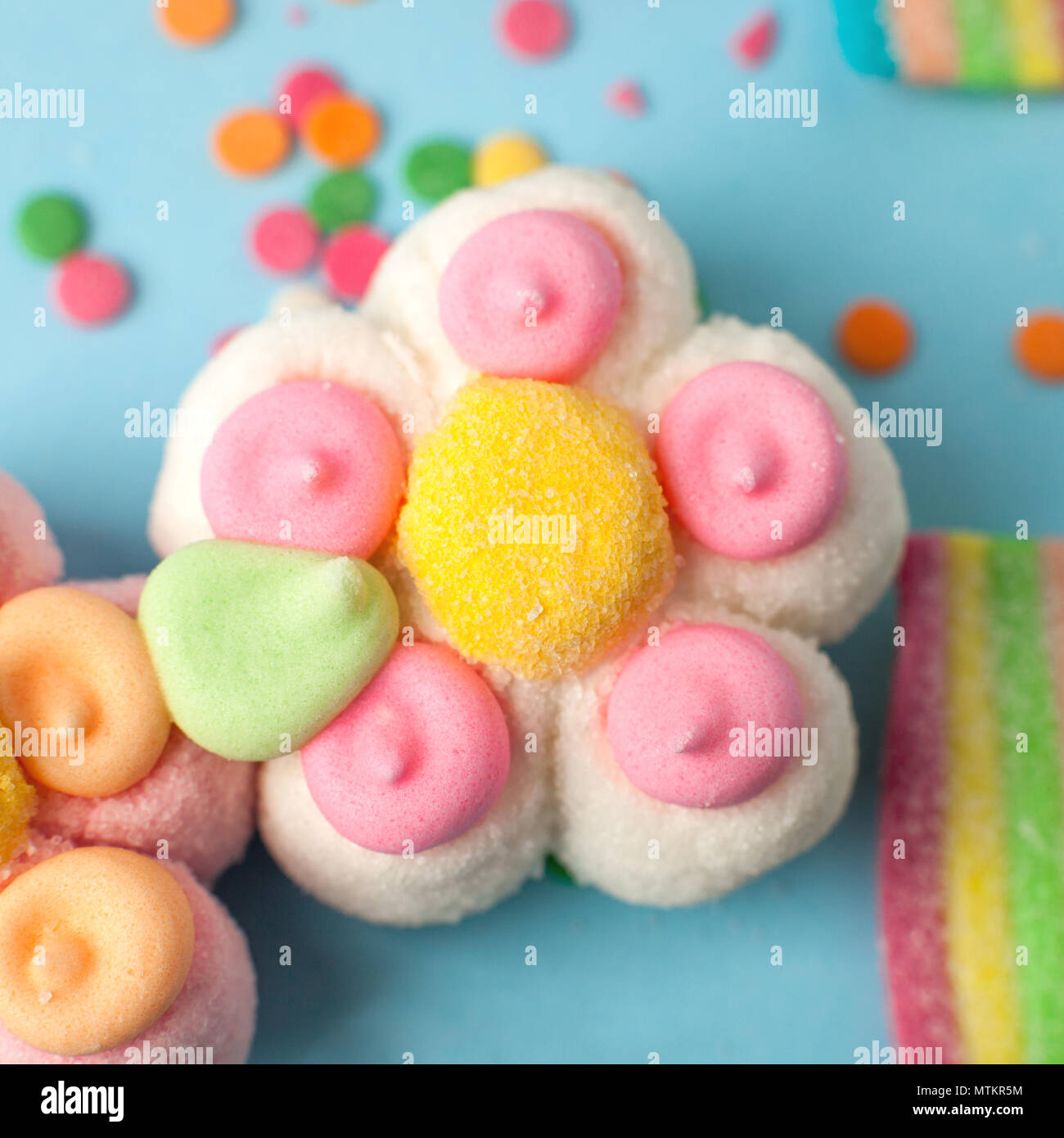 candies with jelly and sugar pattern. colorful array of different childs sweets and treats. Bright party background, kids sweetness flowers marmalade - Stock Image