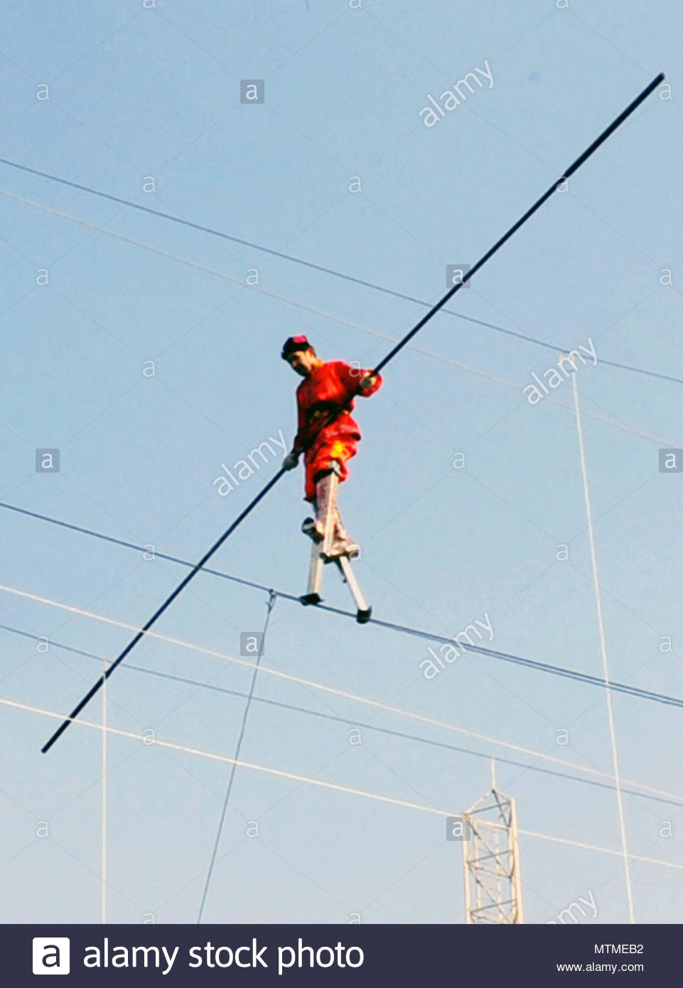 high wire walker. A Chinese daredevil is walking tall after setting ...