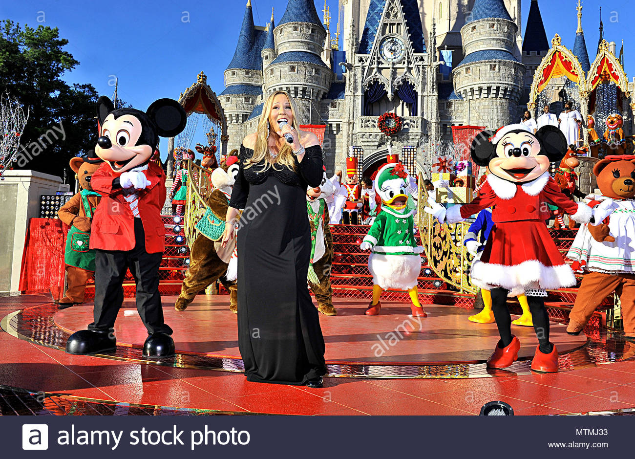 mariah carey a very pregnant mariah carey got the disney royal treatment by arriving to her performance at disney world in a white horse drawn carriage - Mickey Mouse Christmas Songs