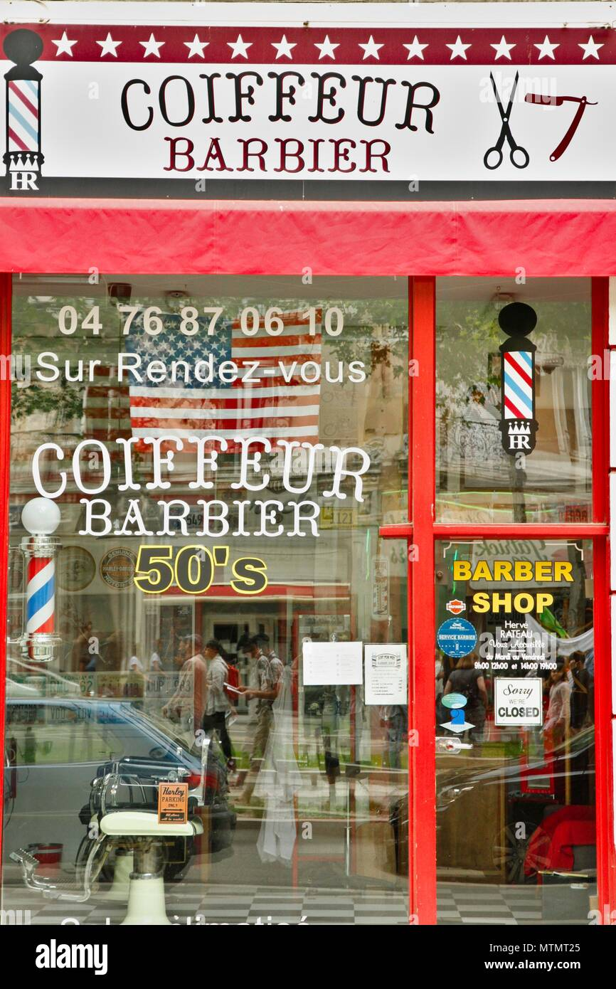 Barber shop with an American, usa, decor and an old sign. Renewal of barbers in France thanks to a clientele of hipsters. Grenoble, Isere Stock Photo