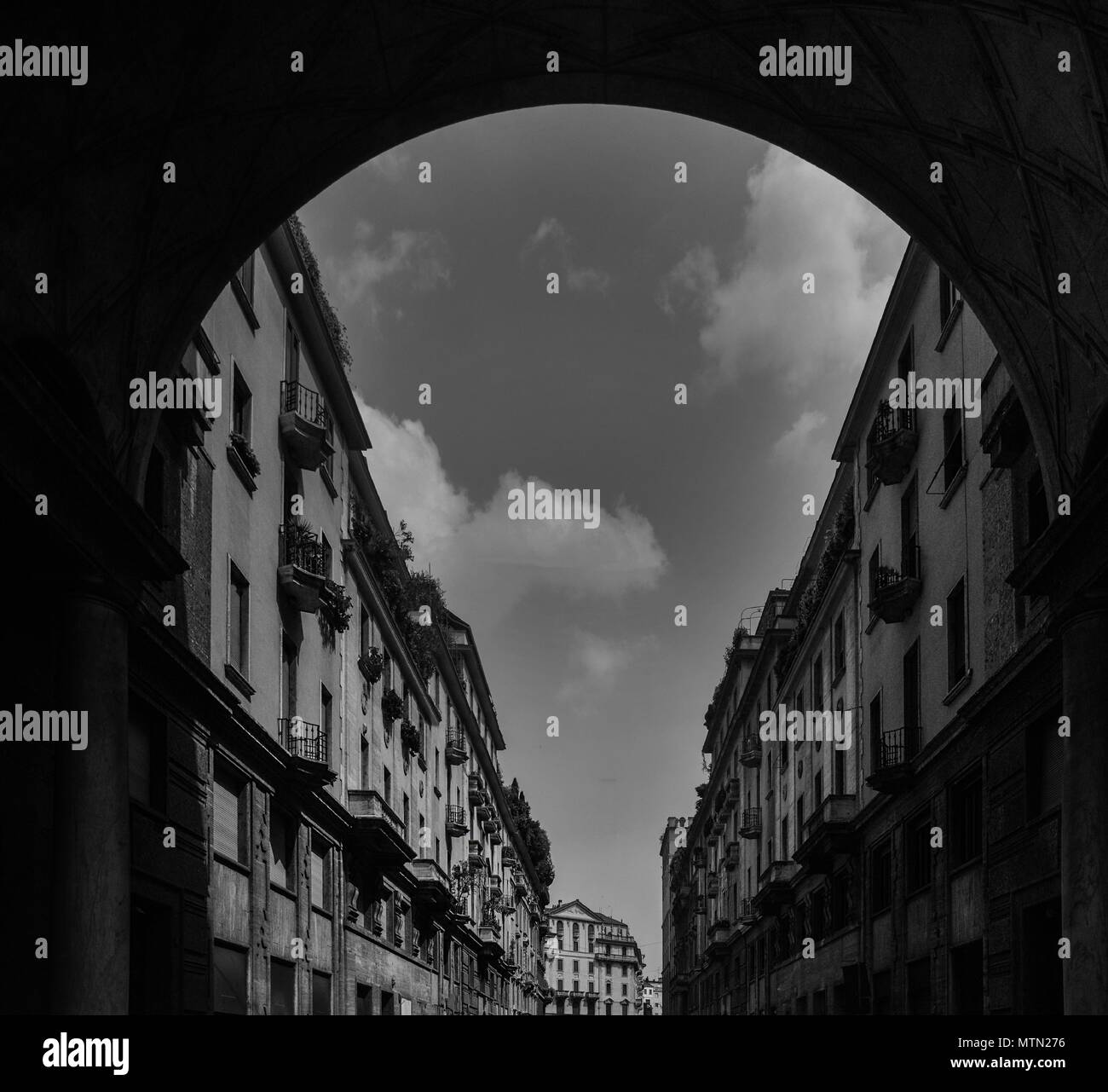Impressive arch frame of traditional Milanese buildings on Via Tommaso Salvini in Milan's Porta Venezia district, Lombardy, Italy - Stock Image