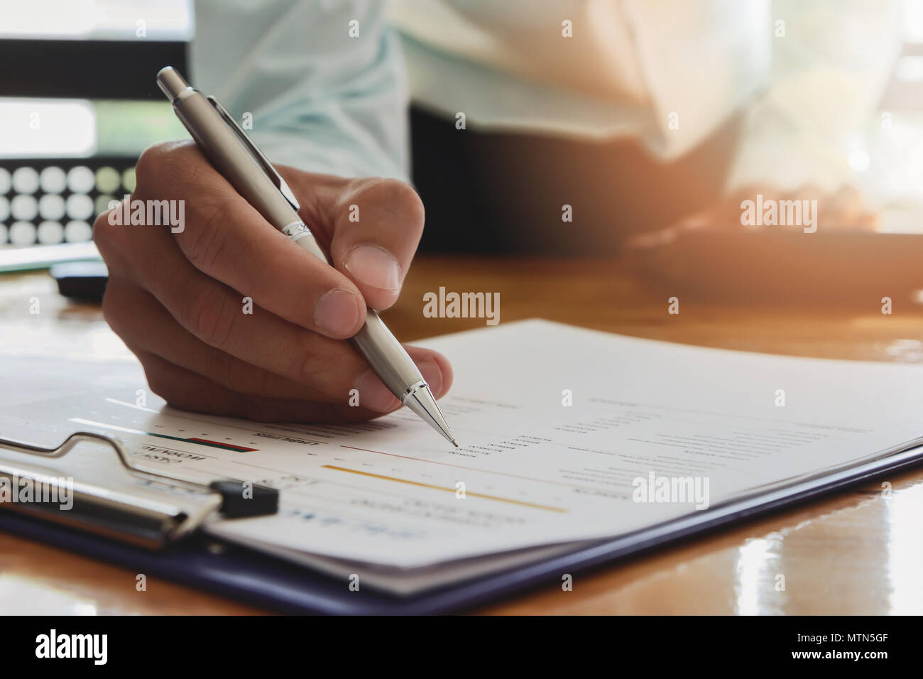 Businessman writing or pointing on report paper. Business strategy concept. - Stock Image
