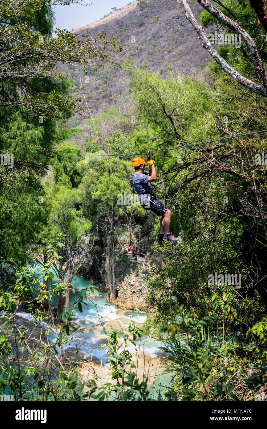Person zipping, Chiflon Waterfall, Chiapas, Mexico - Stock Image