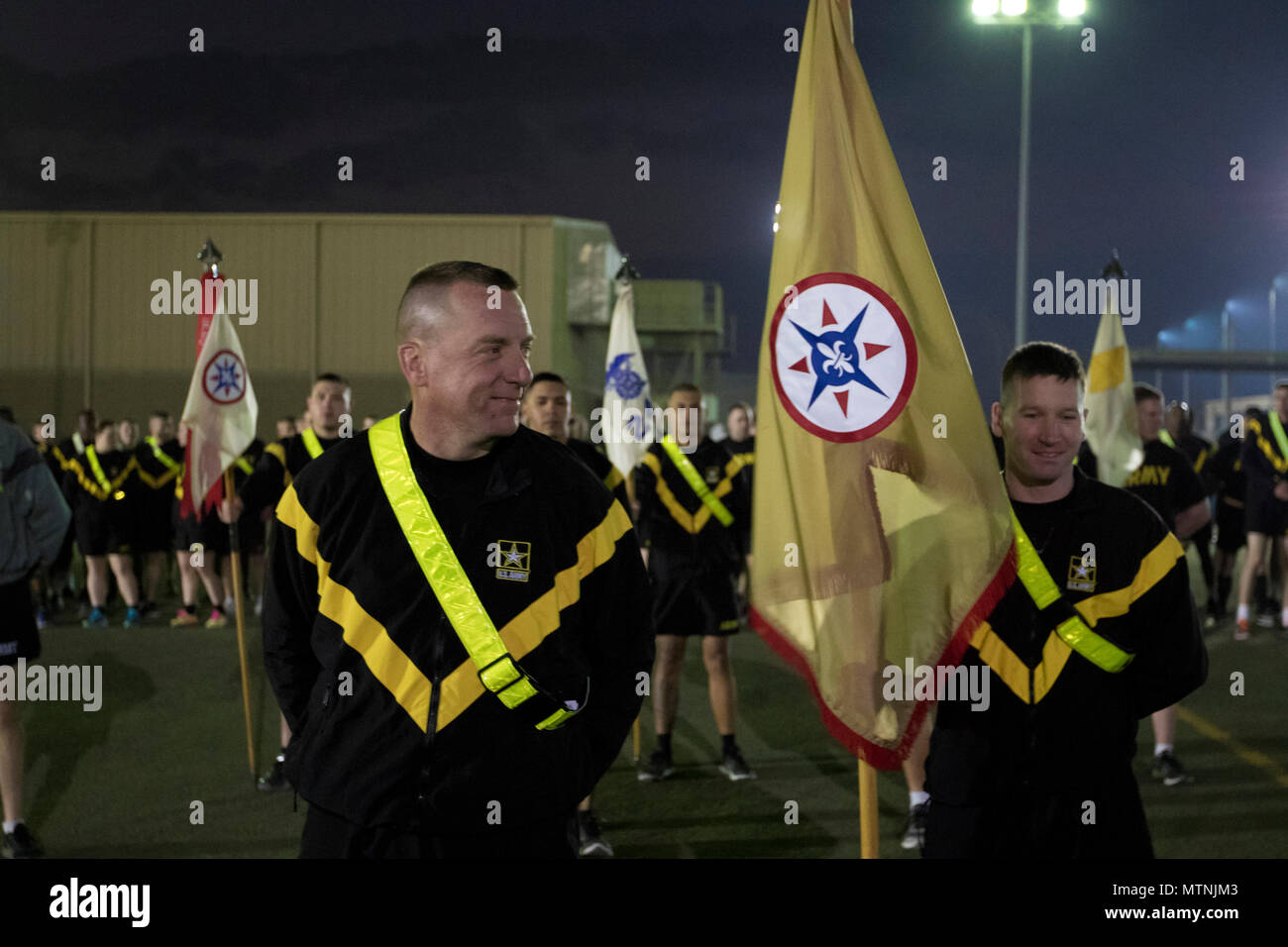 U.S. Army Reserve Soldiers, with the 316th Sustainment Command (Expeditionary), prepare to run a 5K with U.S. Army Reserve Commanding General Lt. Gen. Charles D. Luckey at Camp Arifjan, Kuwait, Jan. 10, 2017. (U.S. Army Photo by Staff Sgt. Dalton Smith) - Stock Image