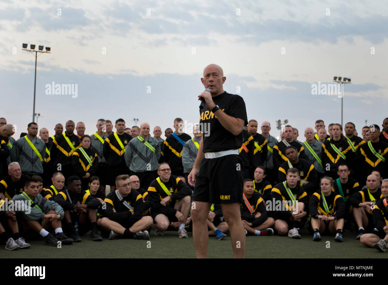 U.S. Army Reserve Commanding General Lt. Gen. Charles D. Luckey speaks with Soldiers from the 316th Sustainment Command (Expeditionary), an U.S. Army Reserve unit from Coraopolis, Pa., after a 5K at Camp Arifjan, Kuwait, Jan. 10, 2017. Luckey spoke with Soldiers about the capabilities, need and importance of their missions overseas. The 316th ESC mission in Kuwait is to support the 1st Sustainment Command (Theater) mission of providing logistics support throughout the U.S. Central Command area of operations. (U.S. Army Photo by Staff Sgt. Dalton Smith) - Stock Image
