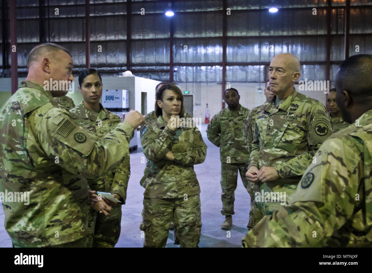 Brig. Gen. Robert D. Harter, commanding general of the 316th Sustainment Command (Expeditionary), (left), explains the process of how equipment is moved through out the U.S. Central Command (USCENTCOM) Area of Responsibility (AOR) to U.S. Army Reserve Commanding General, Lt. Gen. Charles D. Luckey, (right), during a tour the Iraq Train and Equipment Fund (ITEF) warehouse at Camp Arifjan, Kuwait, Jan. 4, 2017. (U.S. Army Photo by Staff Sgt. Dalton Smith) - Stock Image