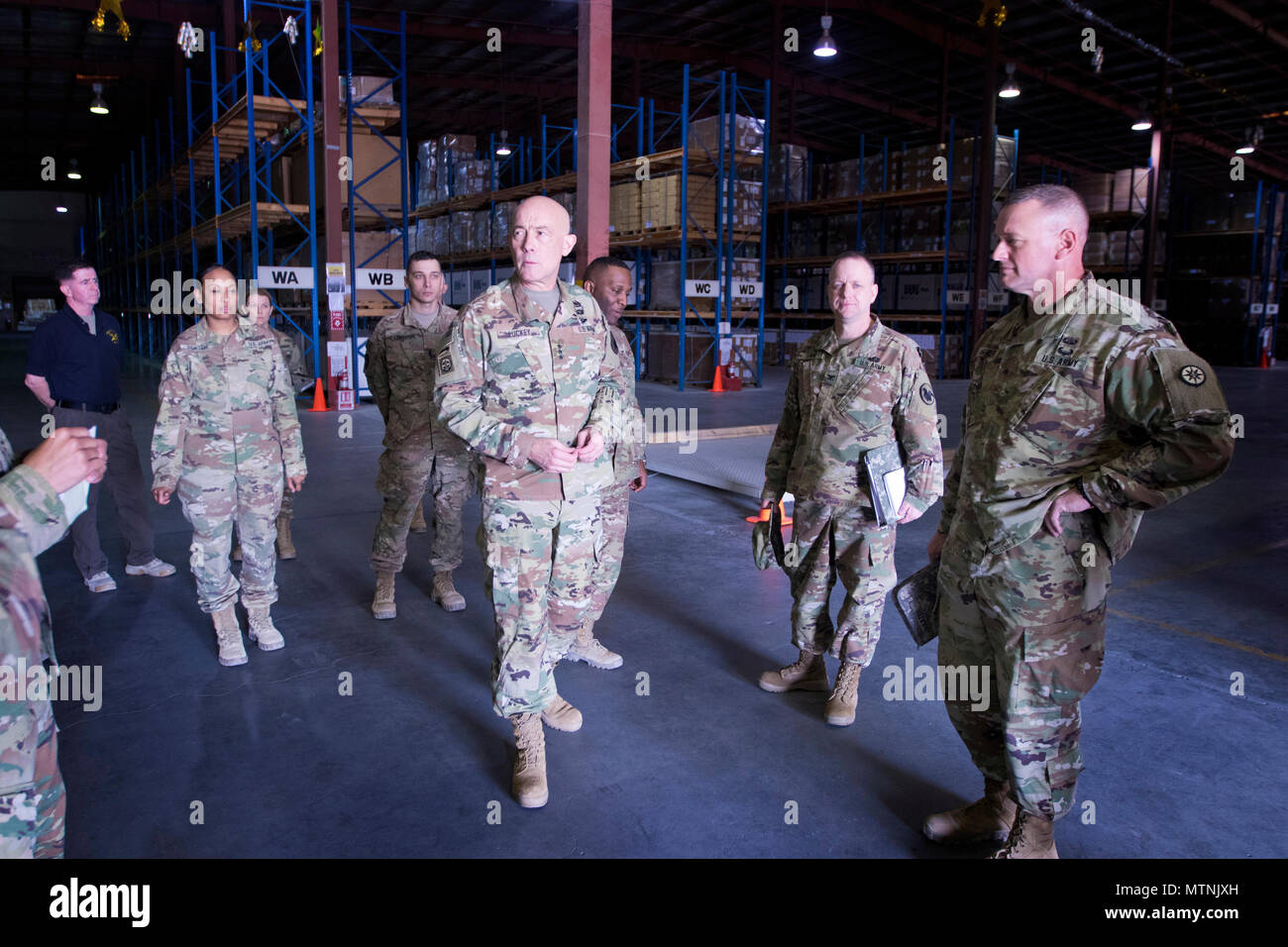 U.S. Army Reserve Commanding General, Lt. Gen. Charles D. Luckey, tours the Iraq Train and Equipment Fund (ITEF) warehouse at Camp Arifjan, Kuwait, Jan. 4, 2017. (U.S. Army Photo by Staff Sgt. Dalton Smith) - Stock Image