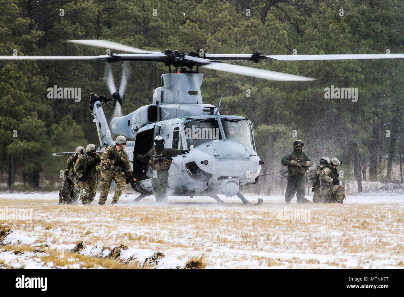 e07dbce6da New Jersey Army National Guard Soldiers with the 1-114th Infantry exit a UH-