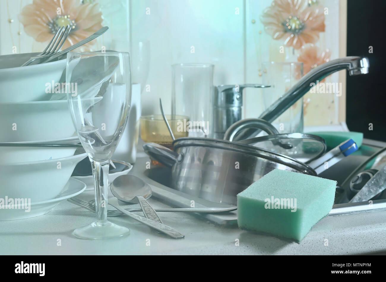 Washing Kitchen Utensils In Sink Stock Photos & Washing Kitchen ...
