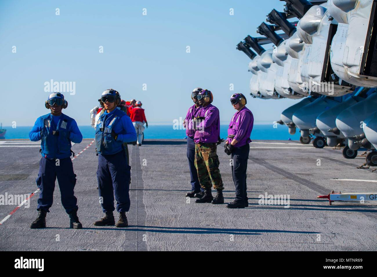 170113-N-AV754-074 ATLANTIC OCEAN (Jan. 13, 2017) Sailors conduct flight operations on the flight deck of the amphibious assault ship USS Bataan (LHD 5). The ship is underway conducting Composite Training Unit Exercise (COMPTUEX) in preparation for an upcoming deployment. (U.S. Navy photo by Mass Communication Specialist 3rd Class Evan Thompson/Released) Stock Photo