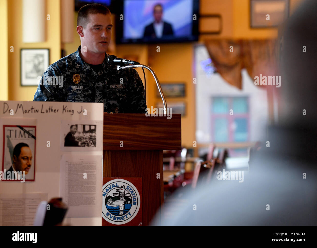 170113-N-WX604-010 EVERETT, Wash. (Jan. 13, 2017)  Master-at-Arms 1st Class John Winjum, assigned to Naval Station Everett (NSE) Security Forces, speaks at a Martin Luther King Jr. Day remembrance ceremony at the All-American Restaurant on base. Dr. King was a civil rights activist who worked to end racial segregation in the United States. (U.S. Navy photo by Mass Communication Specialist 3rd Class Joseph Montemarano/Released) - Stock Image