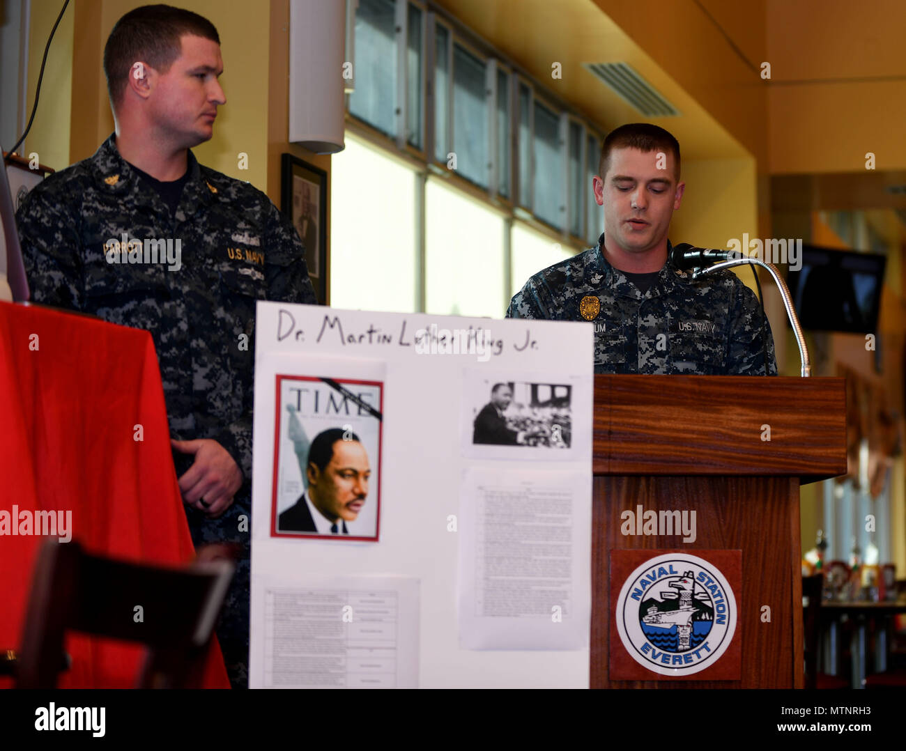 170113-N-WX604-016 EVERETT, Wash. (Jan. 13, 2017)  Master-at-Arms 1st Class John Winjum, assigned to Naval Station Everett (NSE) Security Forces, speaks at a Martin Luther King Jr. Day remembrance ceremony in NSE All-American Restaurant Jan. 13. Dr. King was a civil rights activist who worked to end racial segregation in the United States. (U.S. Navy photo by Mass Communication Specialist 3rd Class Joseph Montemarano/Released) - Stock Image
