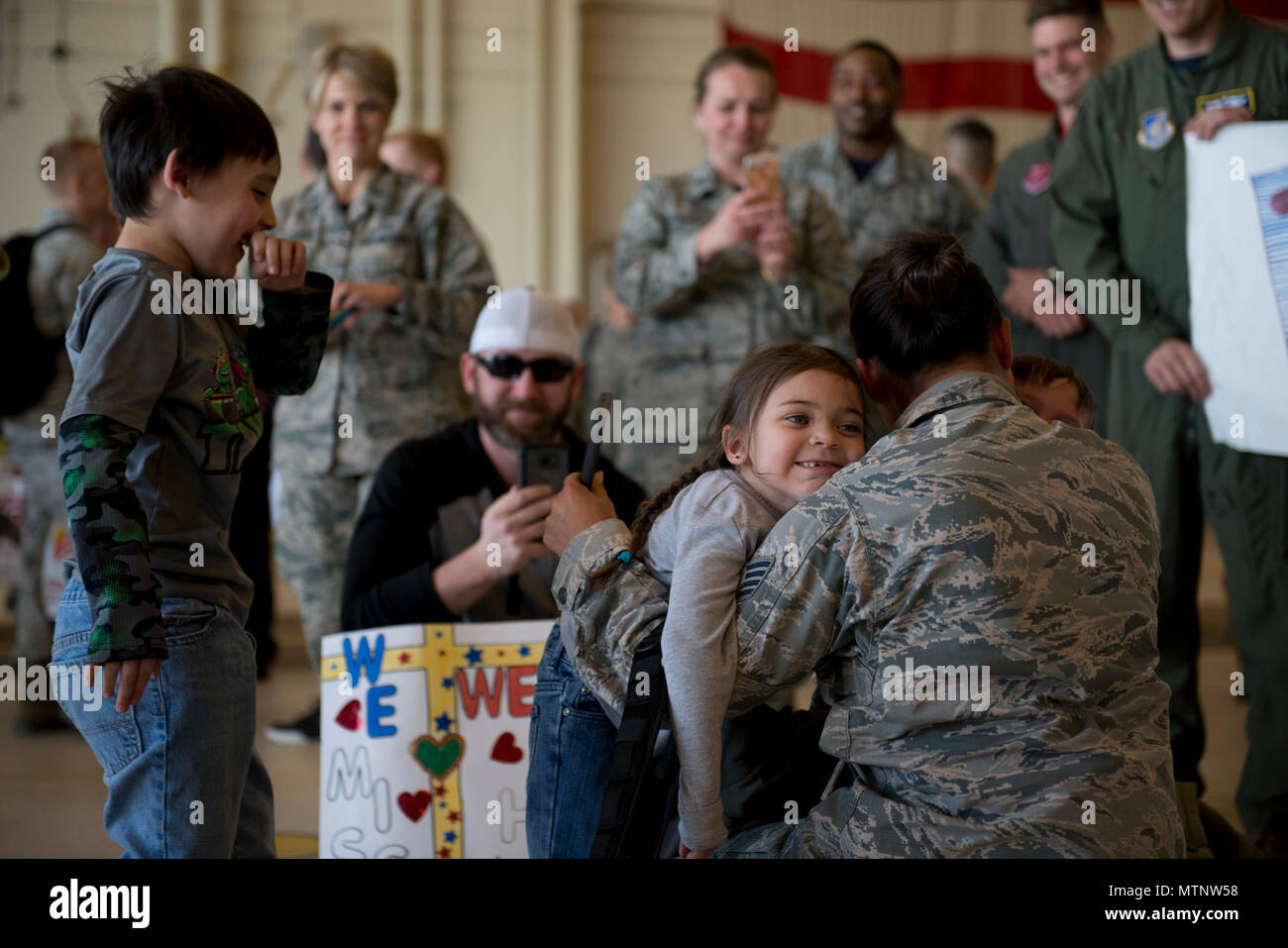 Friends and Families reunite at Hangar 25 on Joint Base Elmendorf-Richardson, Alaska April 21 as the 525th Fighter Squadron to return from a 7-month deployment. For many families, this was their first time being separated from their loved ones for an extended period of time. - Stock Image