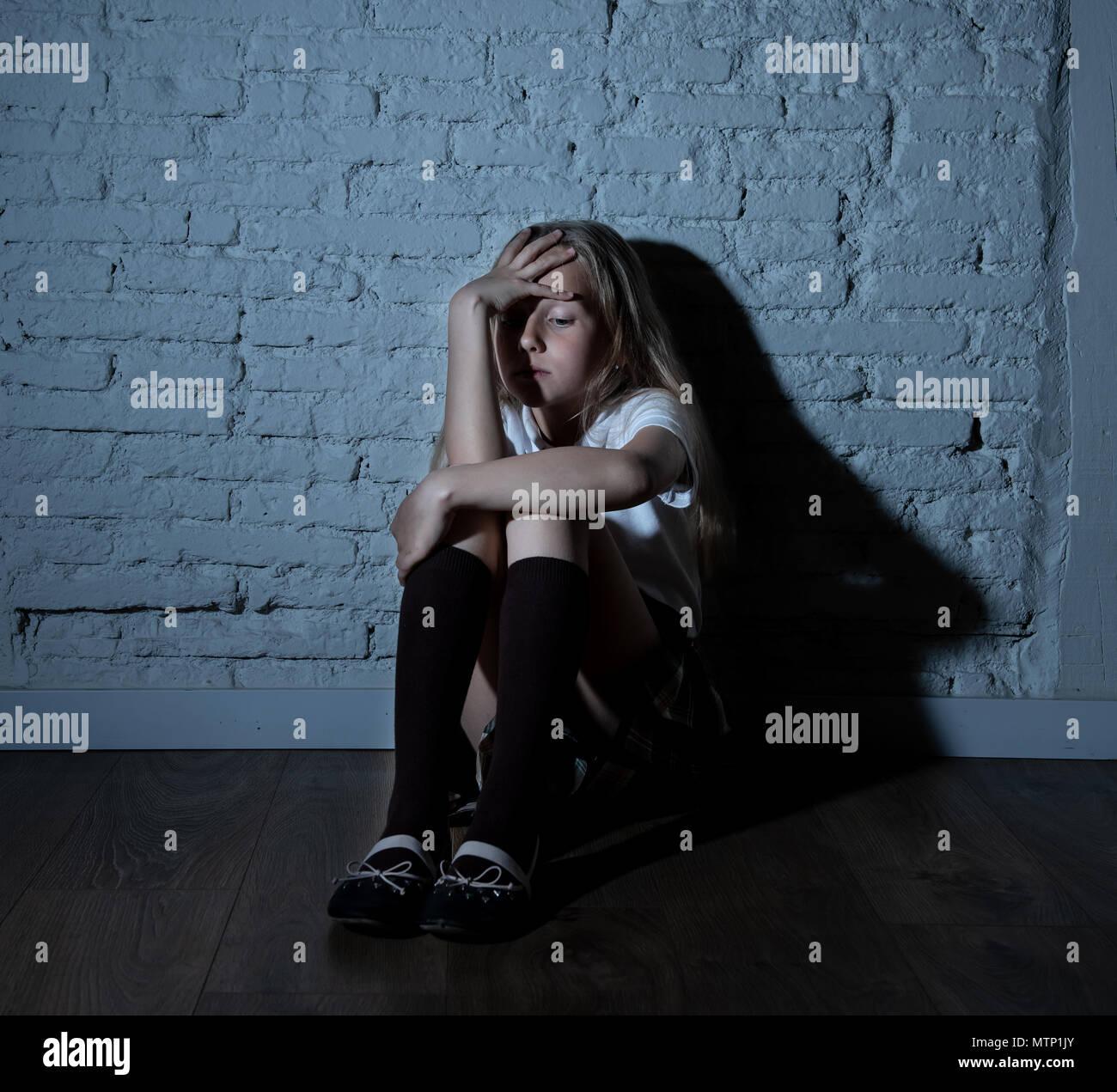 Sad Girl Sitting Against Wall Stock Photos Amp Sad Girl