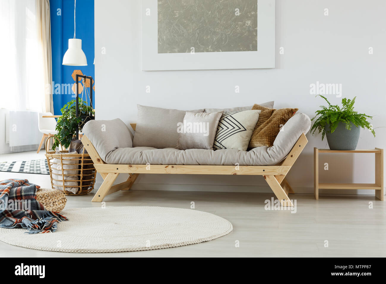 Comfortable Cozy Sofa, Rug, Painting, Pillows, Plants And Natural Eco  Materials In Modern Bright Room