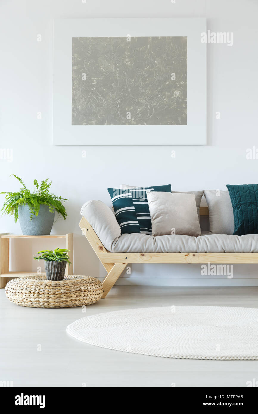 Natural Minimalist Home Decor With White Wall Mock Up Painting Plants Wooden Sofa And Decorative Pillows Stock Photo Alamy