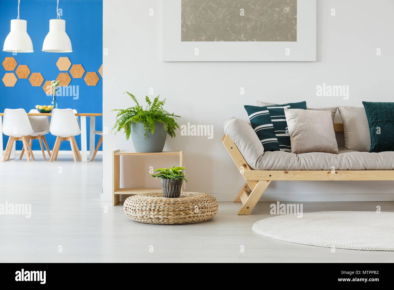 Contemporary bright living room in white and blue decor with couch ...