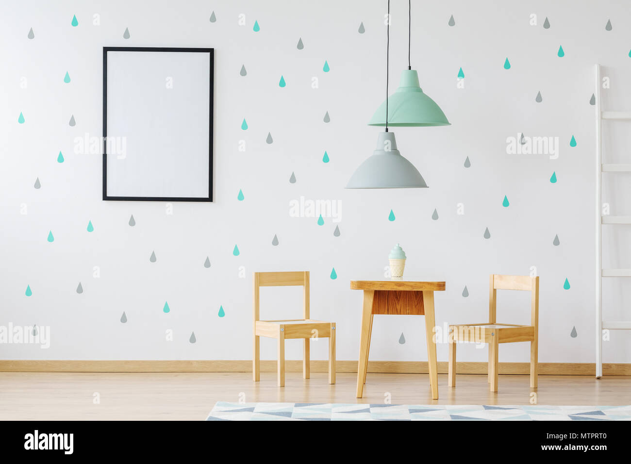 Mockup of poster on wallpaper in child's room with wooden furniture and grey and mint lamps Stock Photo