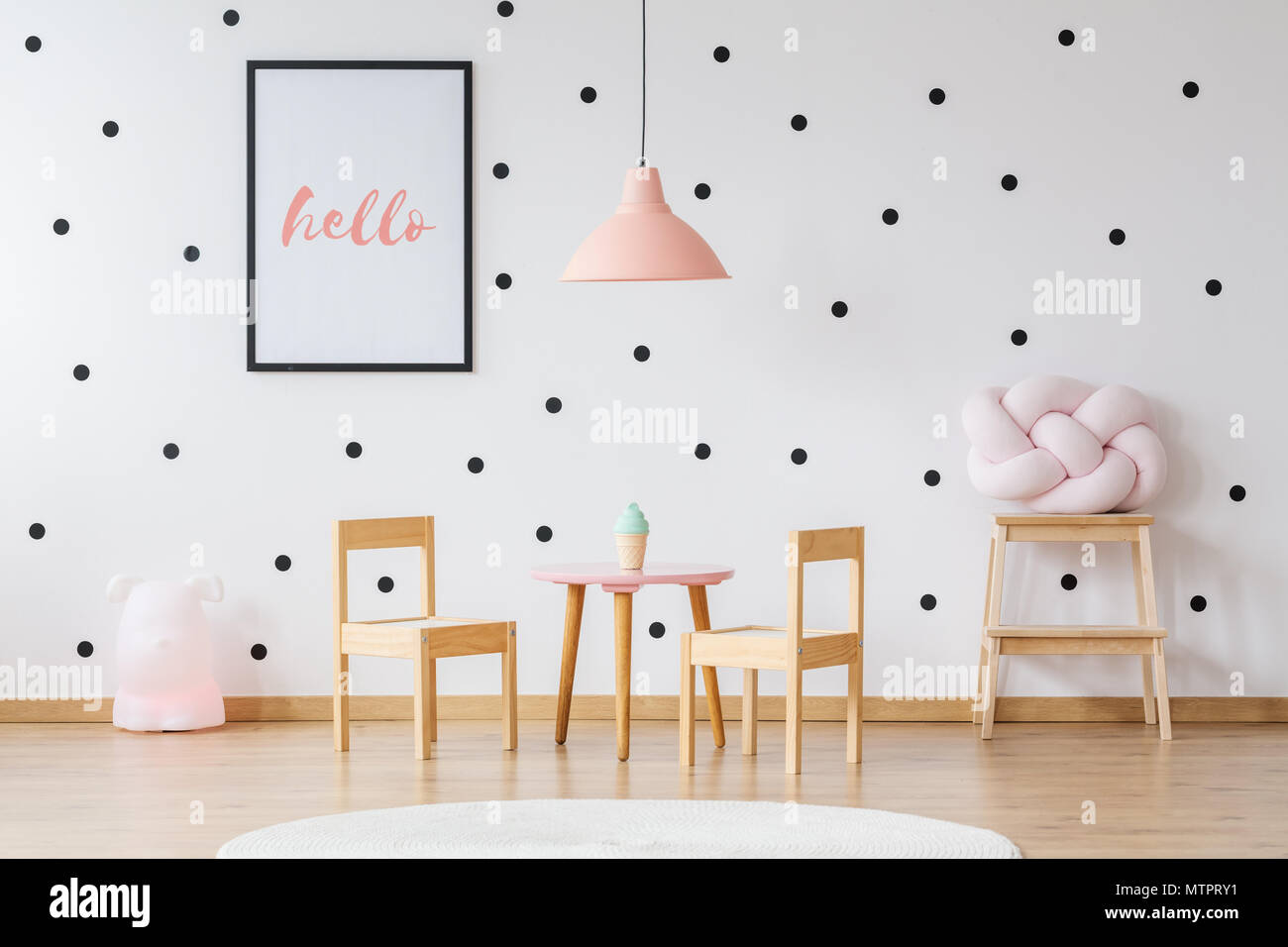 Pink Lamp Above Wooden Table With Chairs In Girl S Room With