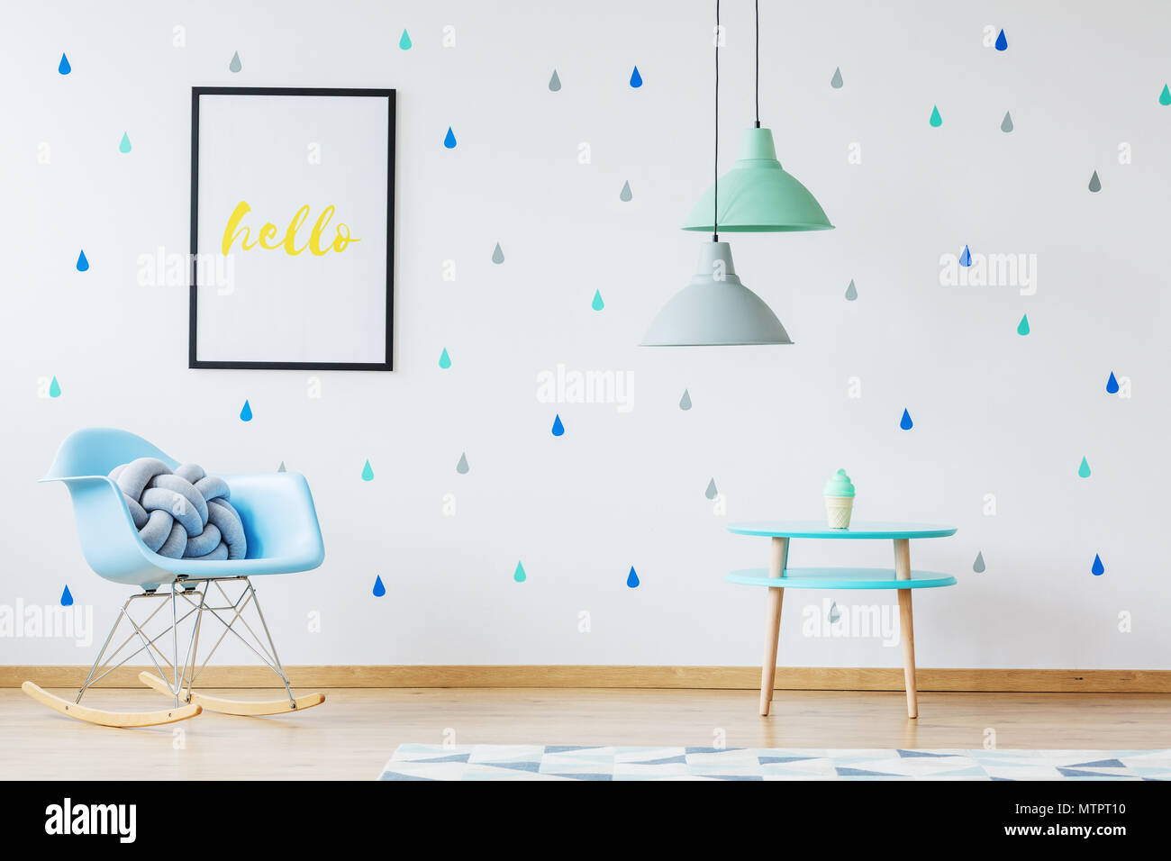 Blue knot pillow on blue rocking chair in boyu0027s room with l&s above table and yellow poster on the wall  sc 1 st  Alamy & Blue knot pillow on blue rocking chair in boyu0027s room with lamps ...