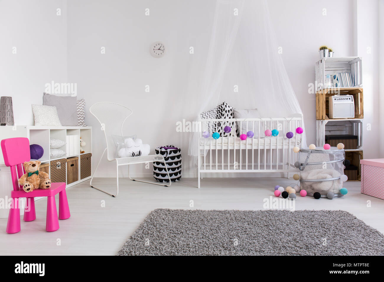 Modern bedroom of little baby girl. White cradle with canopy ...