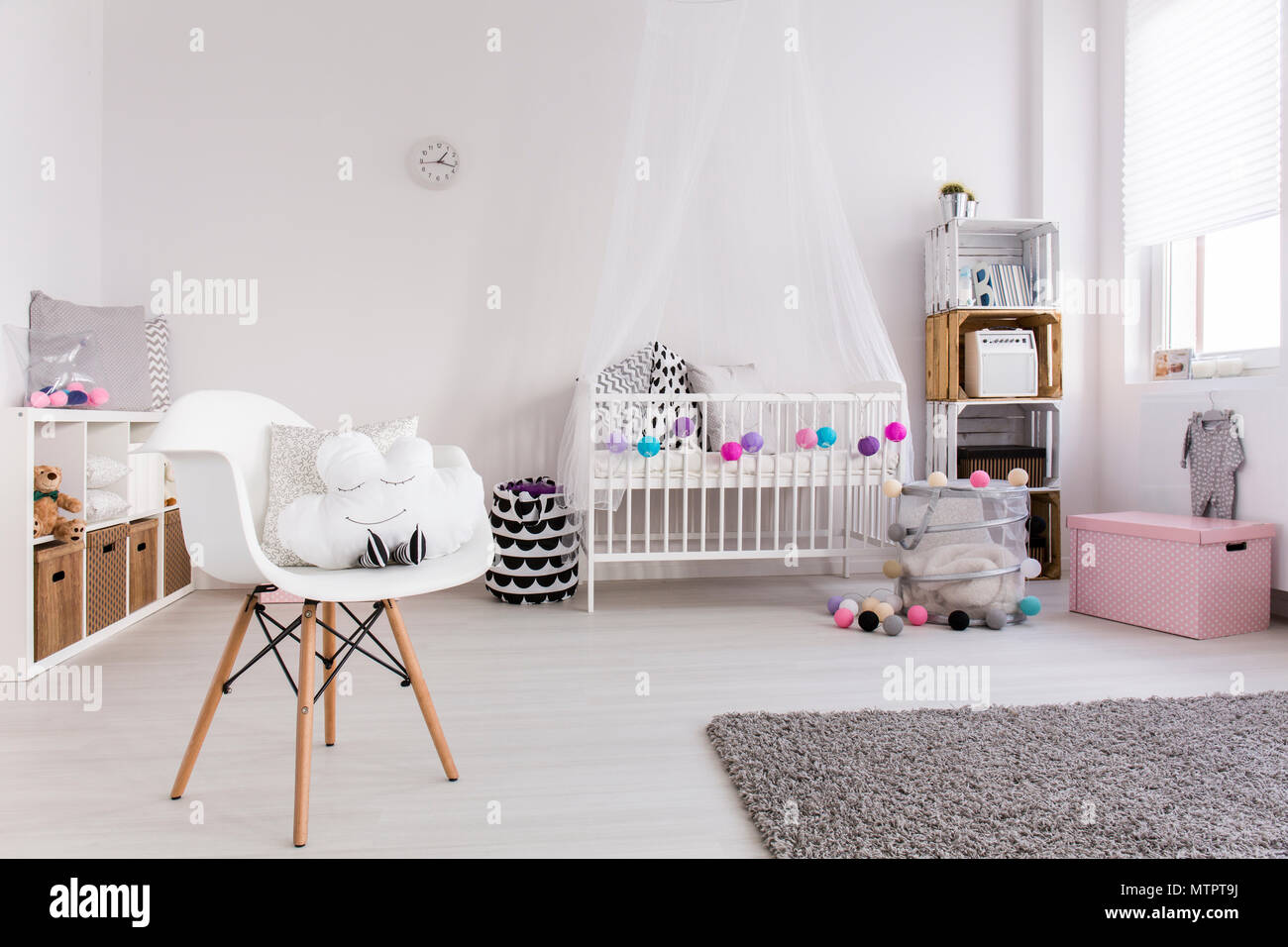 spacious bedroom of baby girl wooden floor with carpet white rh alamy com