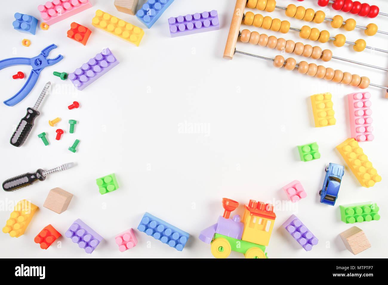 Kids toys frame on white background. Top view. Flat lay Stock Photo ...