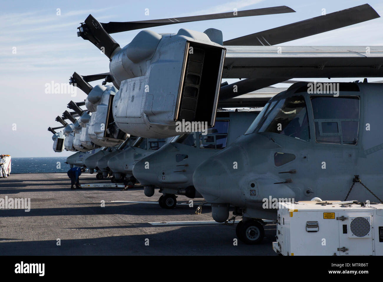 MV-22 Ospreys with the 24th Marine Expeditionary Unit set aboard USS Bataan (LHD 5) during Composite Unit Training Exercise Jan. 14, 2017. COMPTUEX is the MEU's final at-sea evaluation designed for Marines and Sailors to increase operational efficiency for deployment. (U.S. Marine Corps photo by Cpl. Brianna Gaudi) Stock Photo