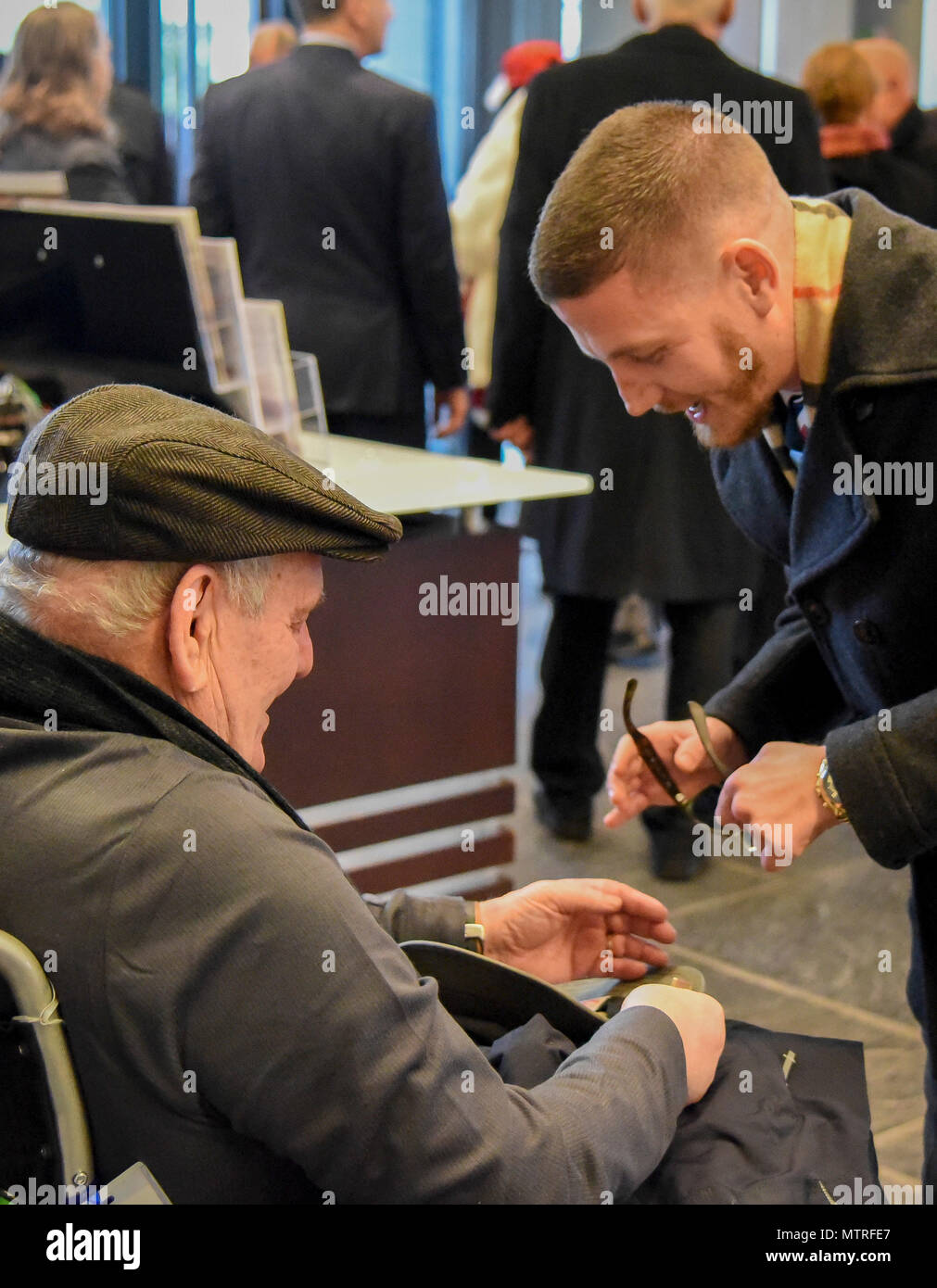 Former U.S. Army Spc. Kenneth Stumpf, Medal of Honor recipient and retired U.S. Marine Corps Cpl. William Kyle Carpenter, Medal of Honor recipient, exchange coins during a traditional Inaugural Day Medal of Honor breakfast held at the Reserve Officers Association headquarters in Washington D.C., January 20, 2017. (U.S. Army Reserve photo by Master Sgt. Marisol Walker/Released) Stock Photo